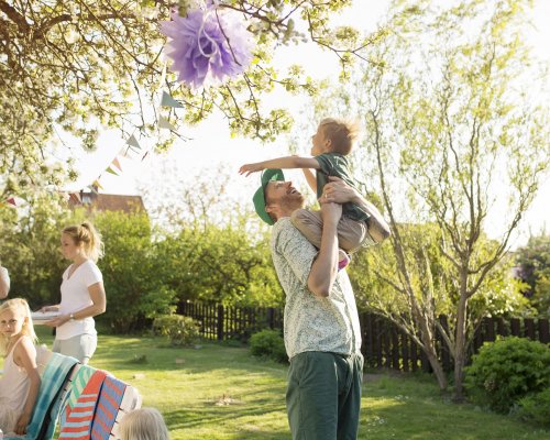 Family playing in garden